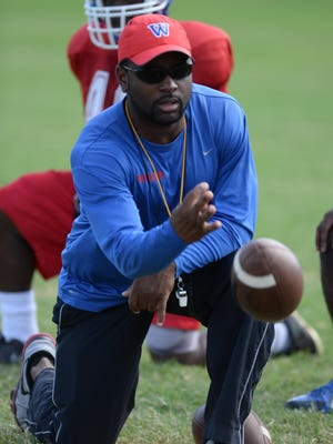Douglas Collier/The TimesWoodlawn coach Jerwin Wilson and the Knights could make a bold statement with a win at Haughton. Jerwin Wilson remains head coach for Woodlawn's 2014 season.