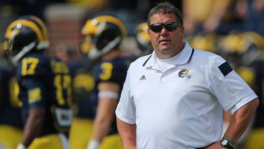 Michigan football coach Brady Hoke watches the warm-ups before a game against the Miami RedHawks at Michigan Stadium on Sept. 13, 2014, in Ann Arbor.
