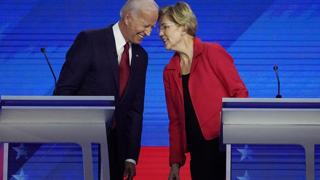 In this Sept. 12, 2019, file photo Democratic presidential candidates former Vice President Joe Biden, left and Sen. Elizabeth Warren, D-Mass., talk during a Democratic presidential primary debate hosted by ABC at Texas Southern University in Houston. Warren has been mentioned as a possible choice in a Biden Administration, if he ultimately prevails over Donald Trump.