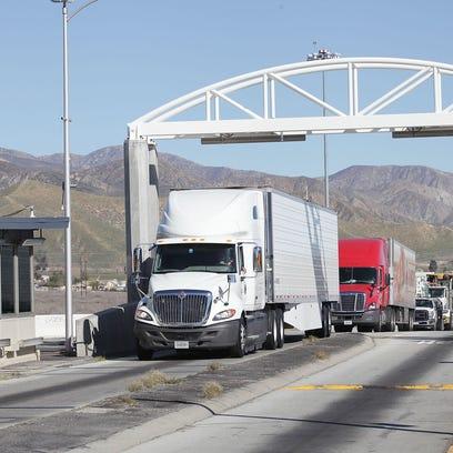 Commercial semi-trailer trucks line up at the Desert