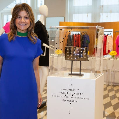 Lisa Perry poses with her Scintillator clutch at Barneys