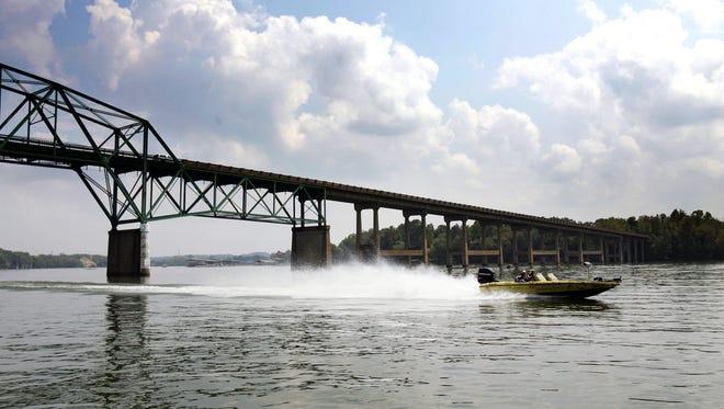 Fishermen race past the Highway 109 bridge between Sumner and Wilson Counties in this file photo.