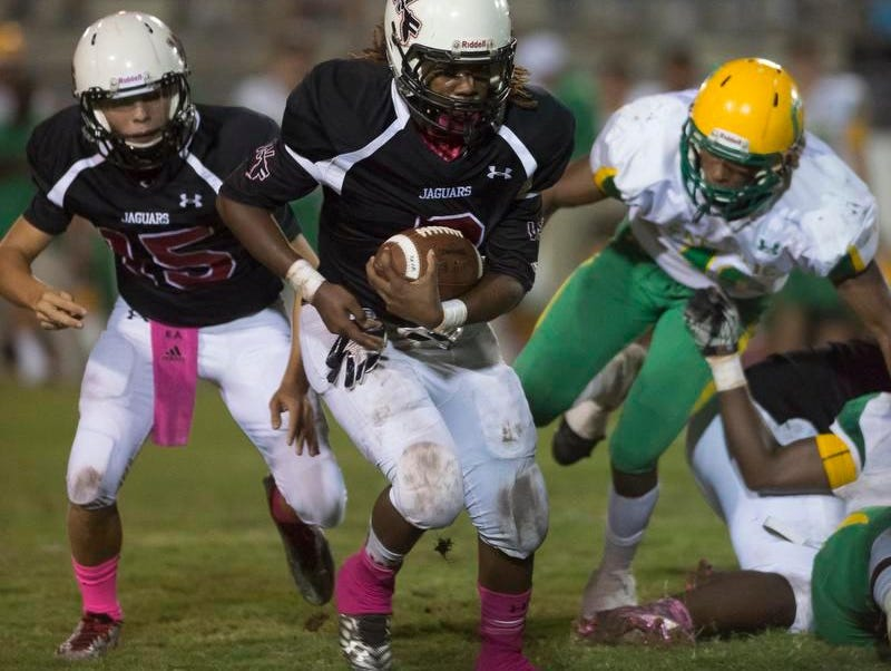 West Florida's Marquise Ross bounces it outside last Friday in a win over Catholic.