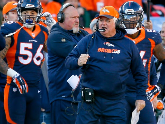FILE - In this Dec. 13, 2015, file photo, Denver Broncos defensive coordinator Wade Phillips pumps his fist during the first half of an NFL football game against the Oakland Raiders in Denver. Phillips has won The Associated Press NFL Assistant Coach of the Year award. (AP Photo/Joe Mahoney, File)