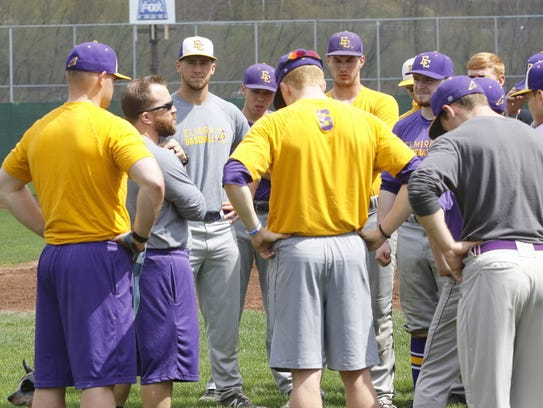 Elmira College head coach Corey Paluga, second from