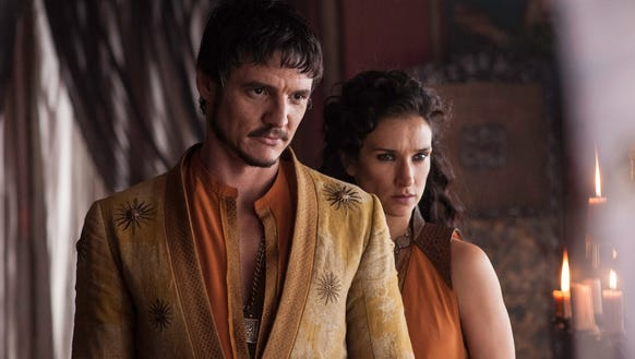 Pedro Pascal as Oberyn and  Indira Varma as Ellaria