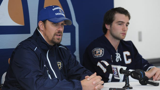 Greenville Road Warriors head coach Dean Stork, left, was let go by the team on Thursday.