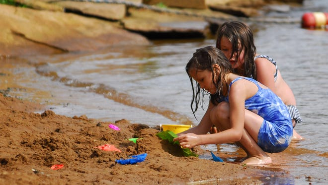 Two young girls enjoy a summer day at Nepco Lake County Park in this 2008 Daily Tribune Media photo.