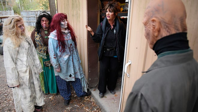 Tammy Molitor, Molitor's Haunted Acres meets with the scare masters and security staff before the start of the show Thursday, Oct. 15 in Sauk Rapids.