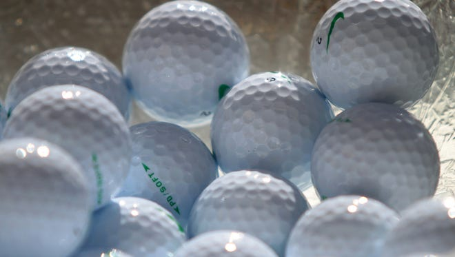 A bowl of golf balls is set out for players during check-in for an annual golf scramble with golfers from The First Tee of the Coachella Valley and clients from Desert Arc on Tuesday, May 6, 2014 at the Sunnylands Golf Course in Rancho Mirage, Calif.
