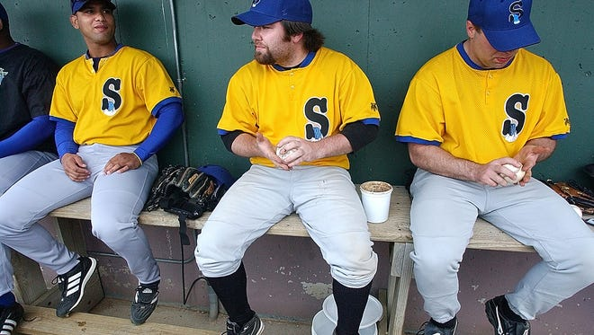 Matt Zimmer (C) sits in the dugout before the Canaries' exhibition game against Sioux City Saturday, May 7, 2006.  (argus leader/ stuart villanueva)