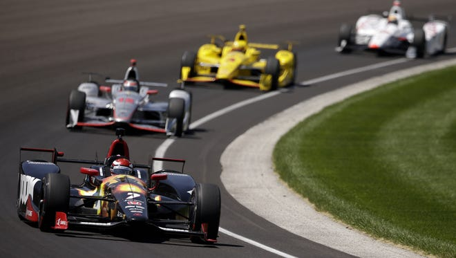 IndyCar driver Mikhail Aleshin rounds turn one during Indy 500 practice at Indianapolis Motor Speedway on May 23, 2016.