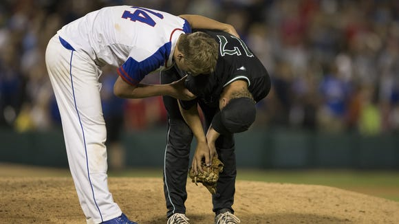 Michael McAvene (left), of Roncalli, consoles losing relief pitcher Jack Pilcher, of Zionsville, after the 4A baseball title game at Victory Field, Indianapolis, Friday, June 17, 2016. Roncalli won 3-2 in extra innings.