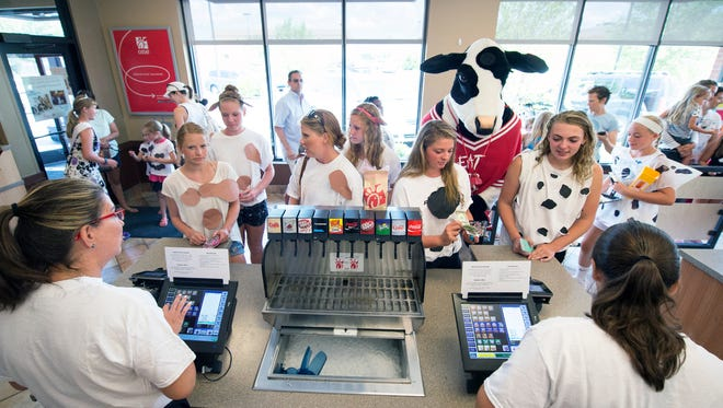 Customers line up dressed in cow for a free entree during Cow Appreciation Day at Chick-fil-a in Springettsbury Township.