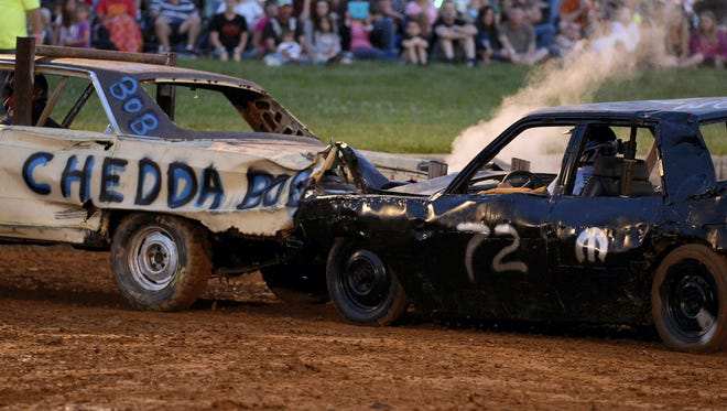 Drivers compete in the demolition derby at the Lebanon Area Fair on Saturday, August 2, 2014, the last night of the fair.