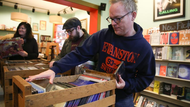 Kevin Hamrick of Nashville sorts through records inside Grimey's Too record store on Black Friday.