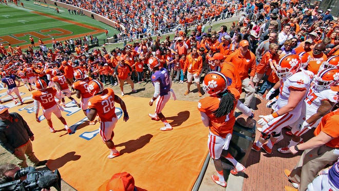 Clemson player run down The Hill after rubbing Howard's Rock during the 2016 spring game at Memorial Stadium in Clemson.