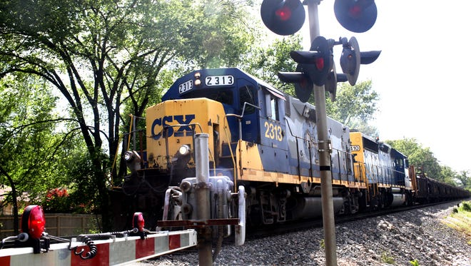 A CSX train approaches Washburn Avenue April 23, 2012 in St. Matthews