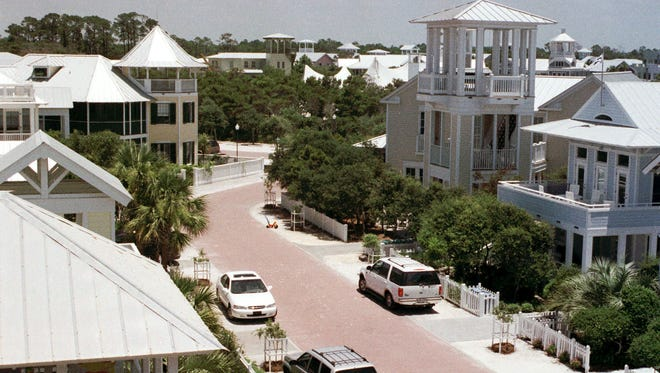 """New Urbanism"" developments have popped up in Freeport and Seaside, seen here in June 19, 1998. Tourists and residents are drawn to its Victorian beach cottages surrounding an open town square with small, trendy shops."