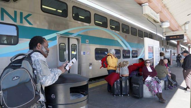 Nick Ut/AP George Jackson Jr. waits to board a Metrolink train to San Bernardino, Calif., in February 2015. a