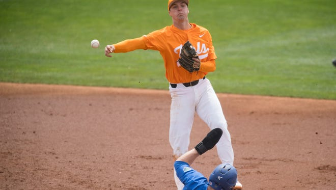 Tennessee's Andre Lipcius forces out Florida's Deacon Liput and throws to first for the double play on Sunday, April 8, 2018.