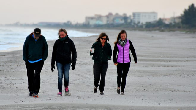 Morning walkers brave 40 degree temperatures in Cocoa Beach in this January, 2015 file photo.