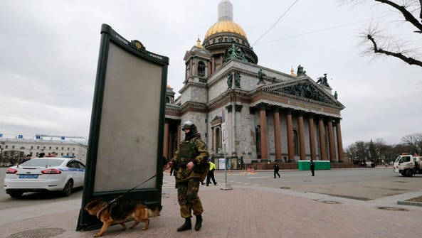 An officer with a dog checks the St. Isaac's square