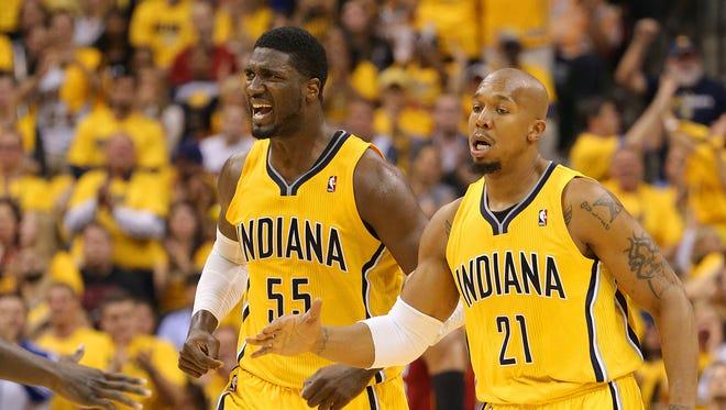 Pacers center Roy Hibbert, left, and forward David West head back up court during the second half of action. Indiana Pacers play the Miami Heat in Game 1 of the NBA Eastern Conference Finals Sunday, May 18, 2014, afternoon at Bankers Life Fieldhouse. The Pacers defeated the Heat 107-96.