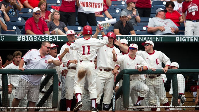Indiana's Will Nolden (11) celebrates with teammates after scoring a run against Nebraska in the bottom of the second inning of an NCAA college baseball game for the Big Ten championship at TD Ameritrade Park in Omaha, Neb.