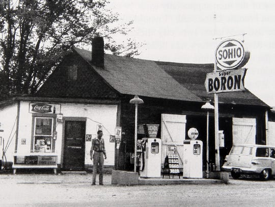 A man named Dugan Adams in front of his gas station