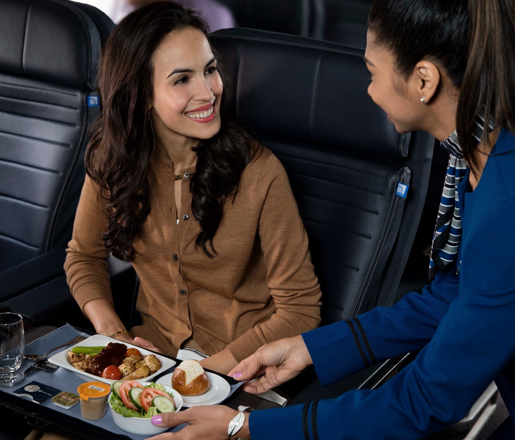 This file photo, provided by United, shows the premium meal service as offered on Latin America routes.