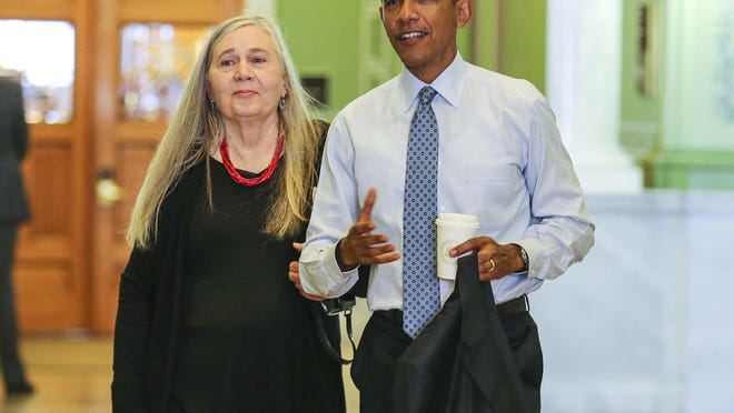 Rodney White/The Register President Barack Obama arrives Monday at the State Library in Des Moines, where he was interviewed by Iowa author Marilynne Robinson. President Barack Obama arrives at the State Library with Iowa author Marilynne Robinson, left, in Des Moines, Iowa, Monday Sept. 14, 2015.