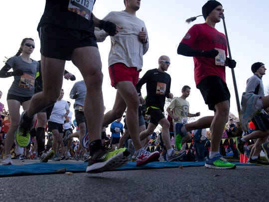 Runners are shown taking part in the Indianapolis Marathon