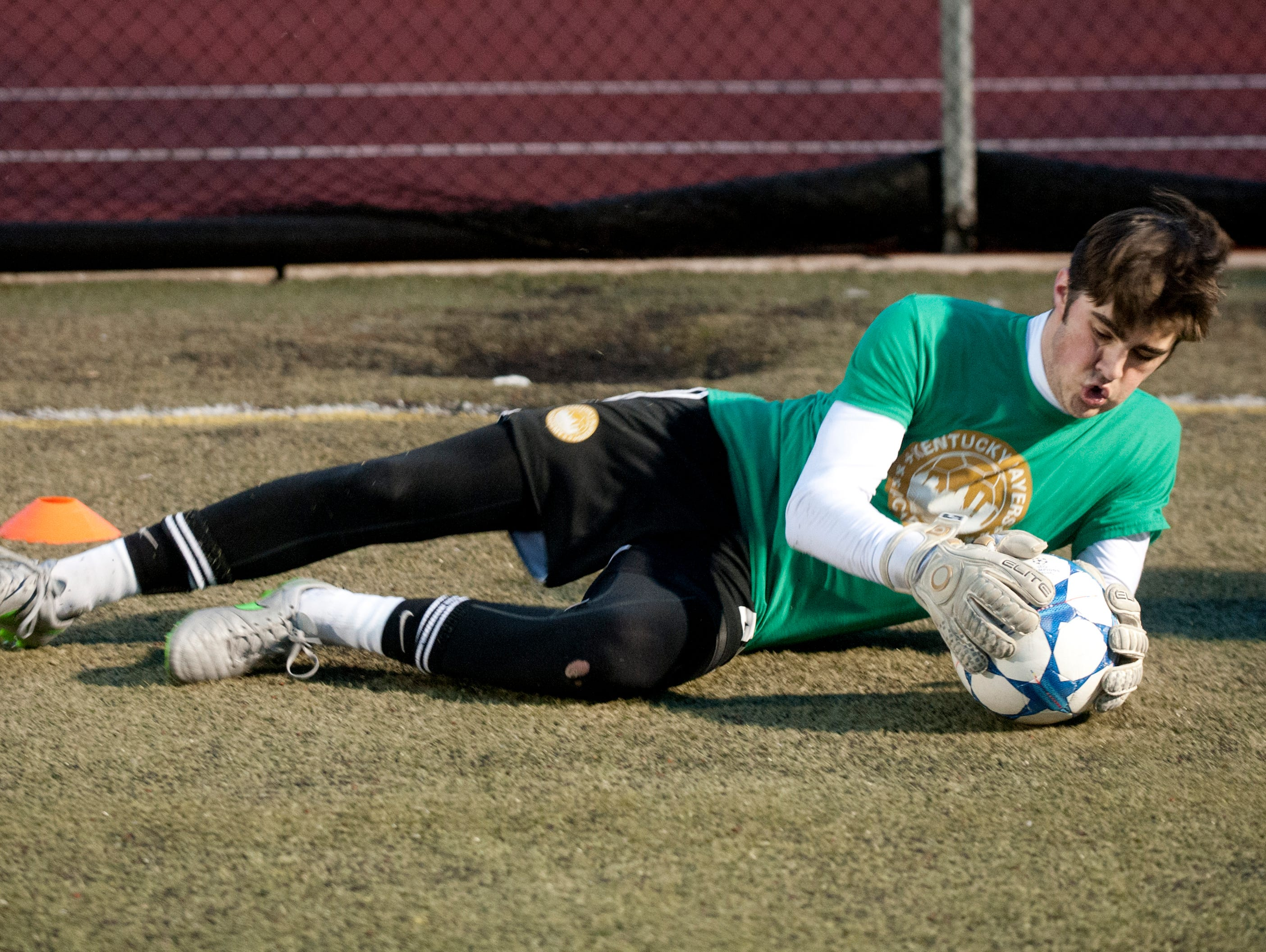 Kentucky Players Academy goalkeeper Aaron Stocksdale catches a ball during practice at St. Xavier High School's field. 15 February, 2016