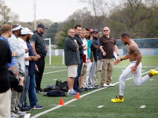 University of Memphis CB Arthur Maulet (right) sprints past scouts and recruiters during pro scouting day at the Billy J. Murphy Athletic Complex on Friday, March 24, 2017.