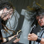 John Moyer, bassist, left, and Dan Donegan, guitarist of the US metal band Disturbed perform on stage during the Greenfield Open Air festival in Interlaken, Switzerland. The band plays Badlands Pawn Thursday, Feb. 25.