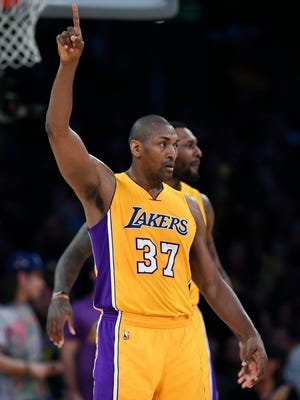Los Angeles Lakers forward Metta World Peace gestures after scoring during the second half of the team's NBA basketball game against the New Orleans Pelicans, Tuesday, April 11, 2017, in Los Angeles. The Lakers won 108-96. (AP Photo/Mark J. Terrill)
