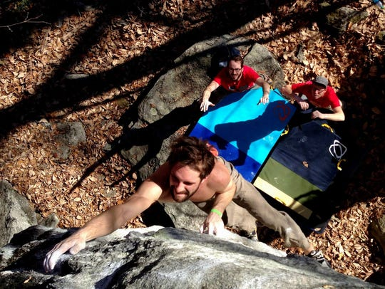 Nathan Charles competes in a past bouldering competition. The Rumble at Rumbling Bald in Chimney Rock State Park is expected to draw hundreds of rock climbers from across the Carolinas Feb. 17.