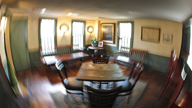 Main living room now a dining room.  The interior of the Sun Tavern in Duxbury which is reported to be haunted on Wednesday October 7, 2020  Greg Derr/ The Patriot Ledger