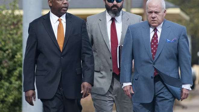Former Mississippi Corrections Commissioner Chris Epps, left, arrives at the U.S. Courthouse in Jackson on Thursday for his arraignment on multiple charges, including bribery, money laundering and wire fraud.  Accompanying Epps is attorney Sherwood Colette, center, and Colette's father, attorney John Colette.