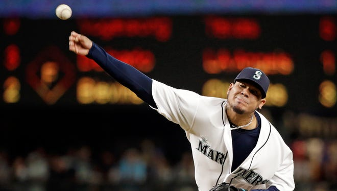 Seattle Mariners starting pitcher Felix Hernandez throws to a Detroit Tigers batter during the sixth inning of a baseball game Wednesday, Aug. 10, 2016, in Seattle.
