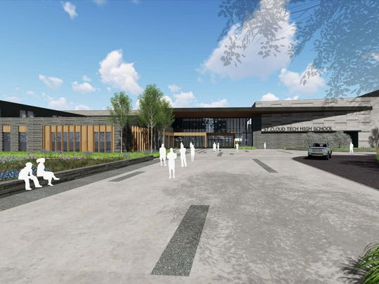 The proposed entrance to the new Tech High School blends granite with wood-like features.