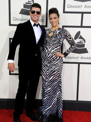 Robin Thicke and Paula Patton attend the 56th Grammy Awards on Jan. 26, 2014 in Los Angeles.