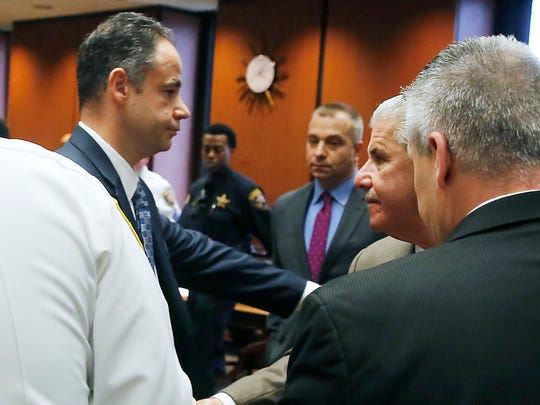 From left to right, Essex County Assistant Prosecutor Ralph Amirata, left, shakes hands with Wayne Amirata, the father of murder victim Dustin Friedland, as they prepare to leave the courtroom moments after a jury found Basim Henry guilty on all counts in the death of Friedland, Friday, March 31, 2017, in Newark, N.J. Henry was one of four men charged with the murder and carjacking of Friedland at an upscale New Jersey mall in December 2013. (Robert Sciarrino /NJ Advance Media via AP, Pool)