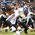 Matt Forte (22) of the Chicago Bears runs past Terrell Suggs (55) of the Baltimore Ravens during the first quarter at Soldier Field in Chicago on Sunday, Nov. 17, 2013. (Jose M. Osorio/Chicago Tribune/MCT)