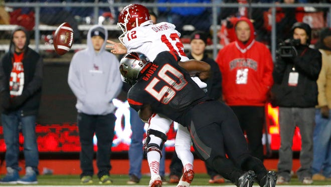 Quentin Gause, shown tackling Zander Diamont last year as the Indiana QB is called for intentional grounding, is a senior linebacker and team captain for Rutgers.