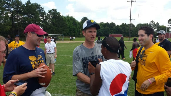 Michigan coach Jim Harbaugh, with Prattville High coach