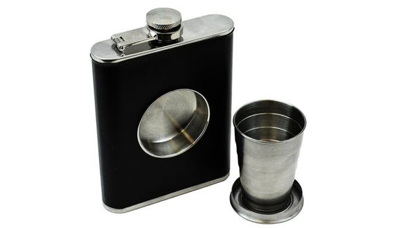 This flask has a built-in shot glass for all your drinking