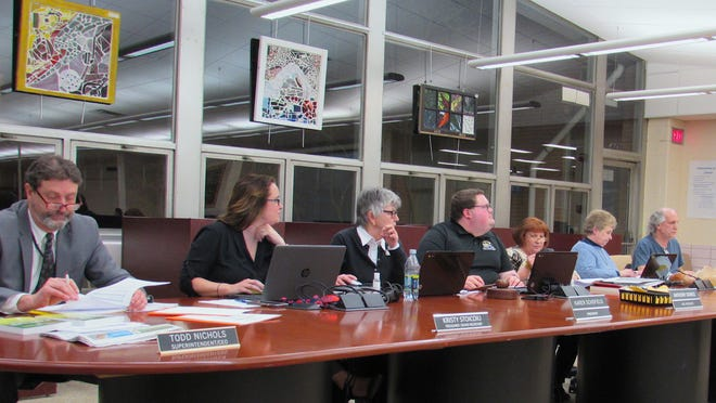 The Cuyahoga Falls Board of Education is pictured at a meeting in early March. The Board on Wednesday, June 3, approved the first step toward putting a levy renewal request on the Nov. 3 ballot. Pictured from left are Superintendent Todd Nichols, Treasurer Kristy Stoicoiu, Board President Karen Schofield, Board Vice President Anthony Gomez, and Board members Patrice White, Kathy Moffet and David Martin.