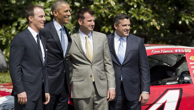 President Barack Obama welcomes, from left, NASCAR 2104 Sprint Cup Series champion Kevin Harvick, Harvick's Stewart Haas Racing crew chief Rodney Childers, and team owner Tony Stewart, during a ceremony on the South Lawn of the White House.